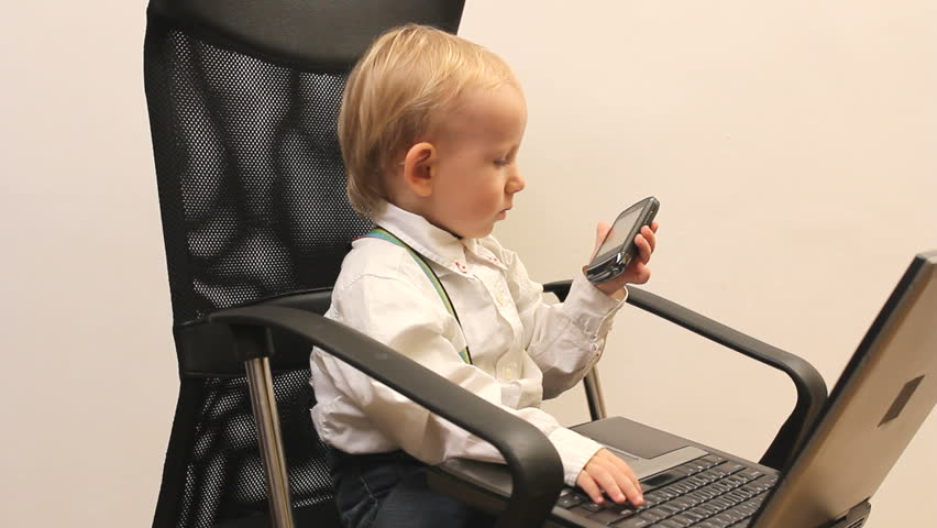 Little Handsome Child With Laptop On Office Chair Stock Footage