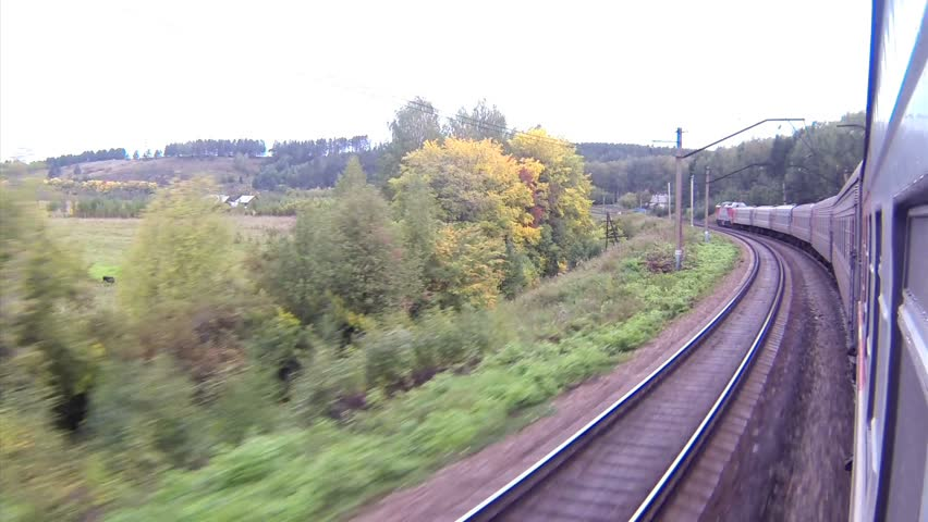 Trans-Siberian Railway train view in a curve with forest
