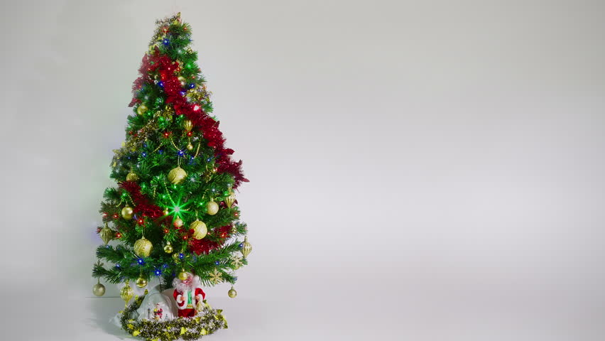 Christmas tree lit colorful lights on background wall in room christmas and new year decoration christmas tree lights twinkling blinking garland timelapse of aloadofball Gallery