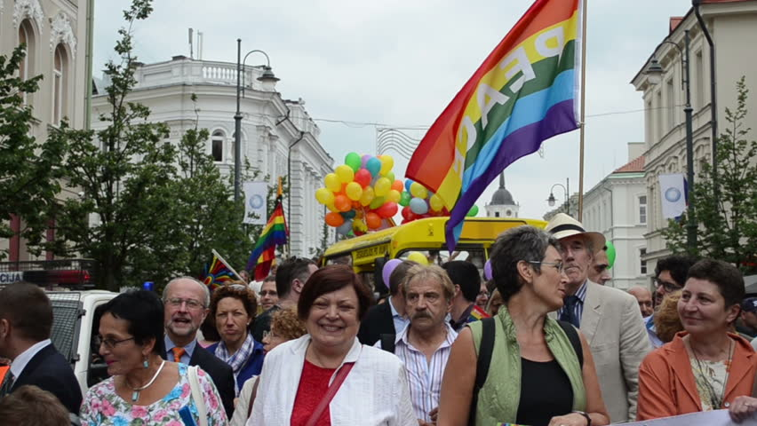 Famous politics people in beginning of gay parade crowd members on July 27,  2013 in Vilnius, Lithuania. Fight for gay and lesbian equality rights.