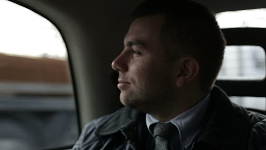 Young Man businessman riding in car