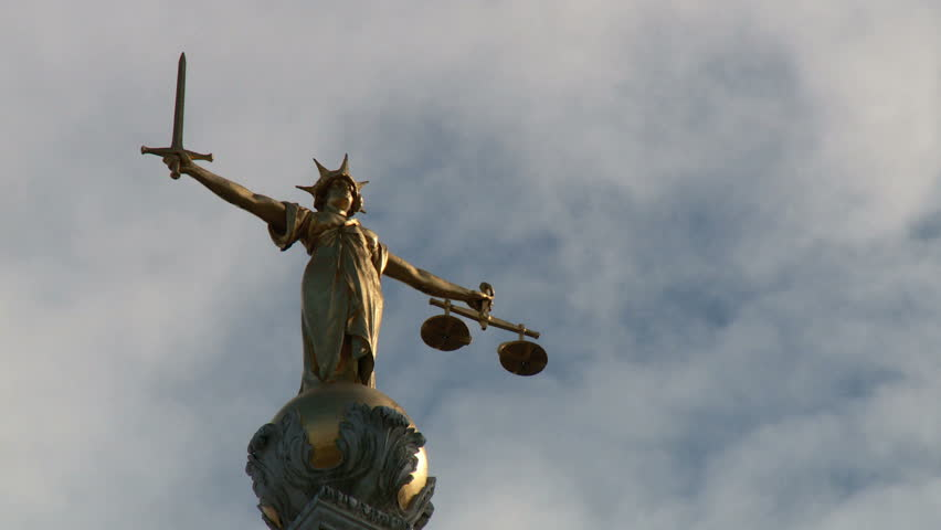 LONDON, UK - CIRCA SEPTEMBER 2013. Time lapse shot of the statue of Lady Justice that sits on top of the Old Bailey.