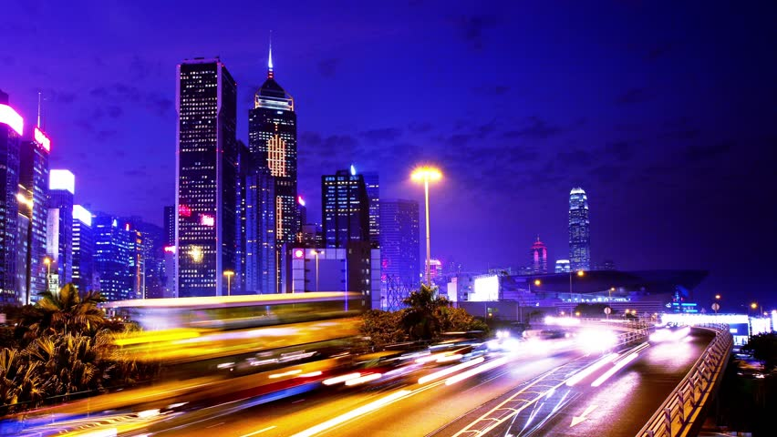 Hong Kong City Night Timelapse. 4K Zoom In Shot.  Hong Kong City timelapse. 4K. Office buildings with flashing lights and electric billboards. Busy traffic at the front in rush hour. | Shutterstock HD Video #5633555
