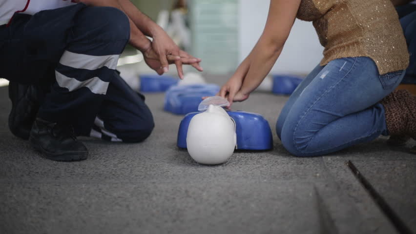 GUANAJUATO, MEXICO CIRCA FEBRUARY 2014: Staged scene: Paramedic teaches to a student apply compressions for CPR  during training session for new volunteers
