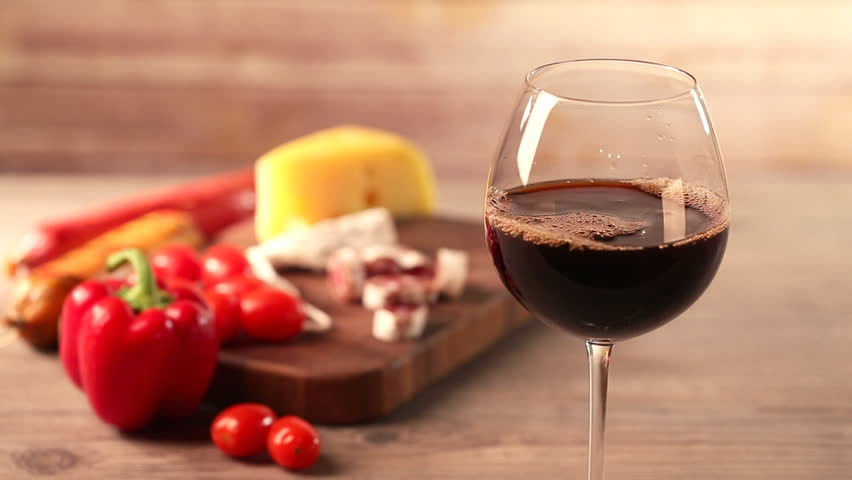Pouring red wine and snacks