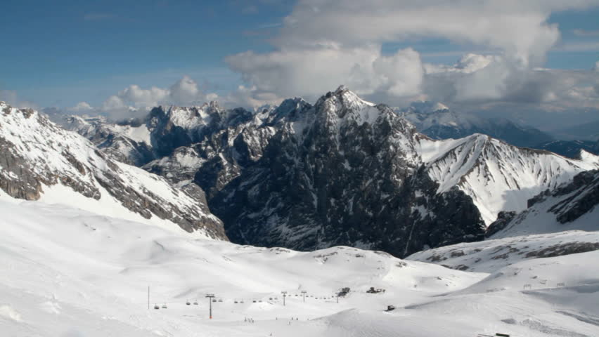 Alpine panorama as seen from the Zugspitz summit station showing the Zugspitz ski resort and many of the surrounding mountains.  | Shutterstock HD Video #5654015