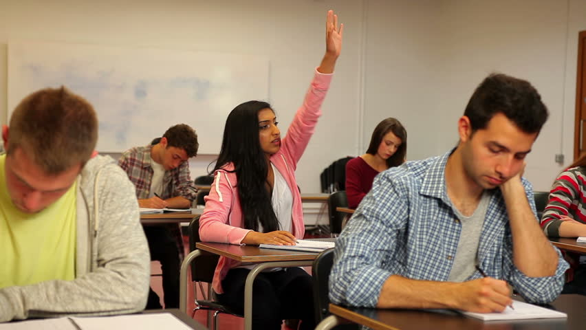 Happy student asking her teacher something in class in a college | Shutterstock HD Video #5669603