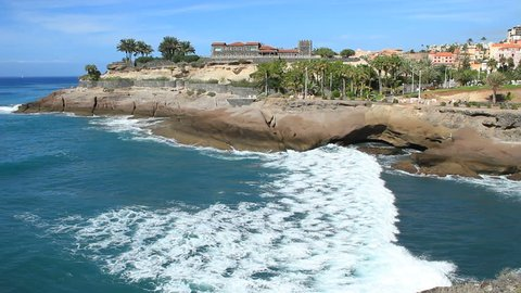 10.11.13 - Tenerife. Beautiful promenade in Playa de Las Americas, near Fanabe beach. With Casa del Duque view. Las Americas is the one of the most popular holiday resort in Tenerife island. Spain.
