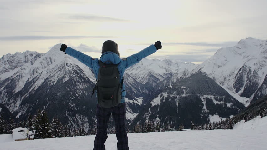Woman standing on mountain peak with arms outstretched, Alps, Austria - HD stock video clip
