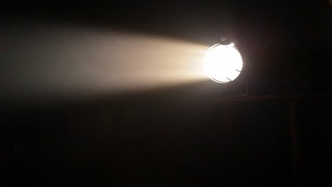 White searchlight moves in the darkness, HD 1080p.