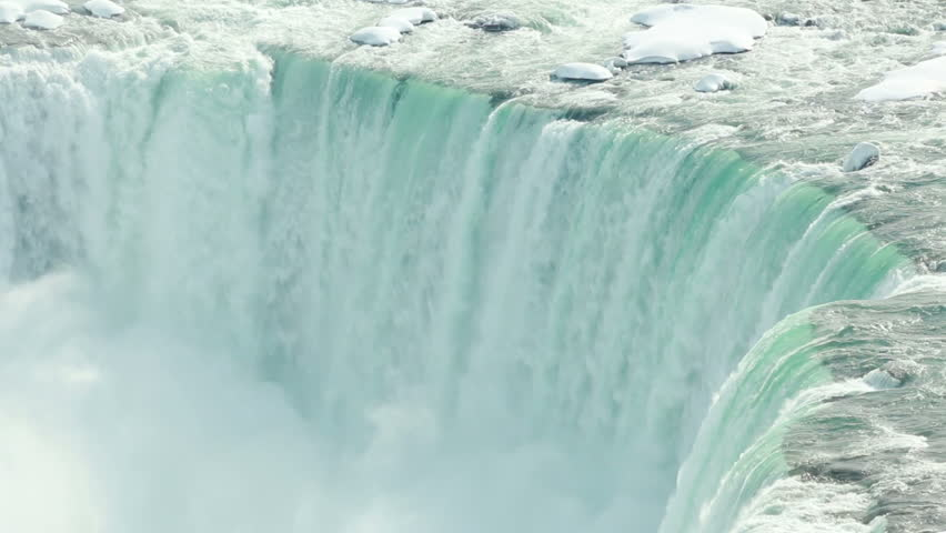 Niagara Falls Winter Edge 1. The Horseshoe Falls section of Niagara Falls during a very cold winter, with heavy snow build up.