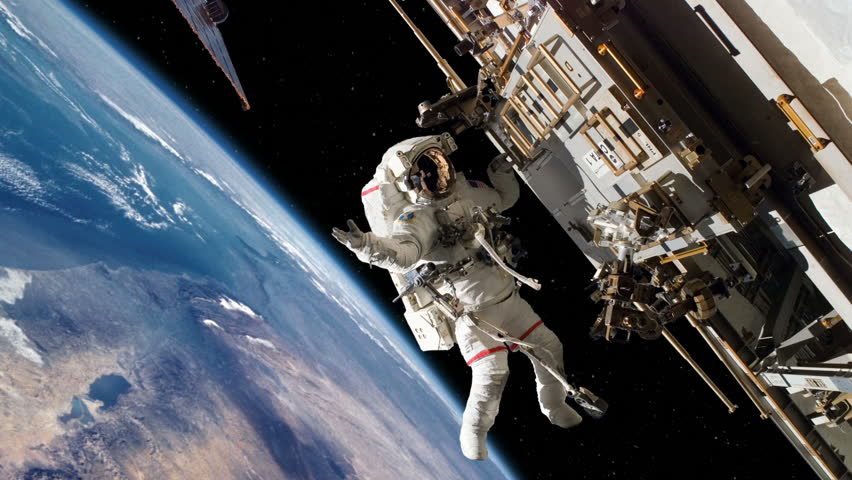 Astronaut Spacewalk Working on International Space Station #5742713