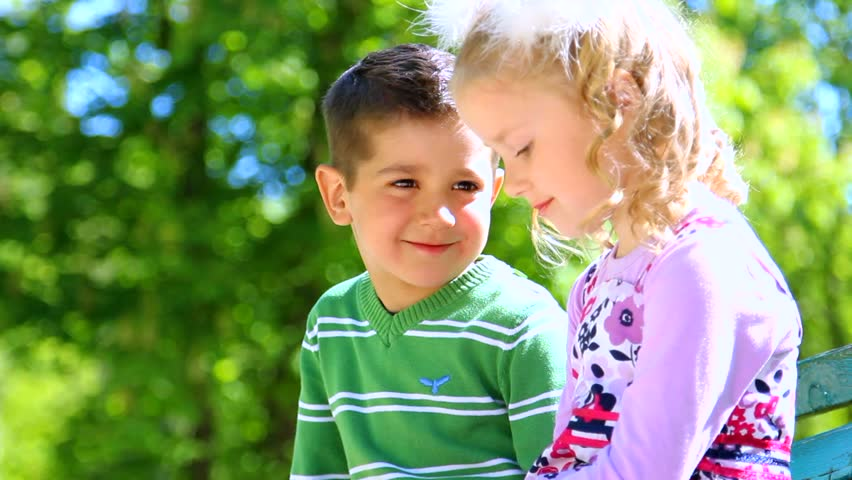 Little child Love Wallpaper : Two cute Kids Are Kissing. Funny couple In Love. children Playing Outdoors. Emotional Kids ...