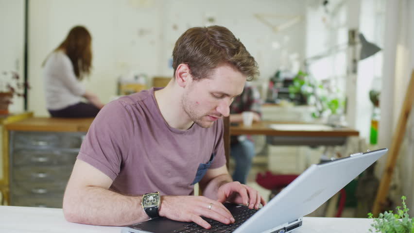 Portrait of a happy young male student, working in a shared study space | Shutterstock HD Video #5763278