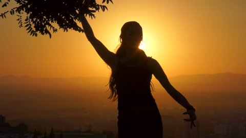 Flamenco Dancer performing at the top of a hill with Granada in the Background