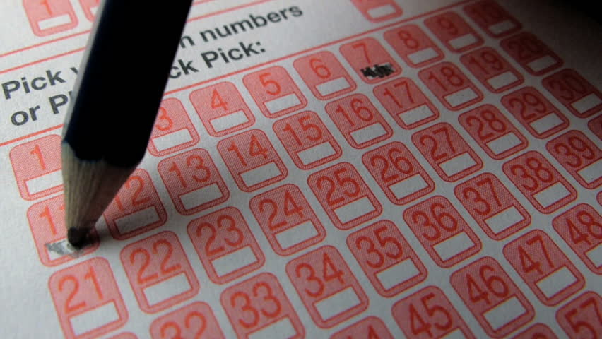 Lottery ticket form being filled out with pencil  | Shutterstock HD Video #5768963