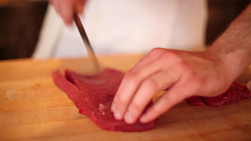 Cutting raw ahi for sushi