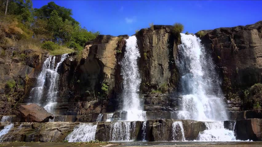 Pongour Falls waterfall in Dalat Vietnam. Scenic mountain river landscape 4K ultra high definition video footage #5807135