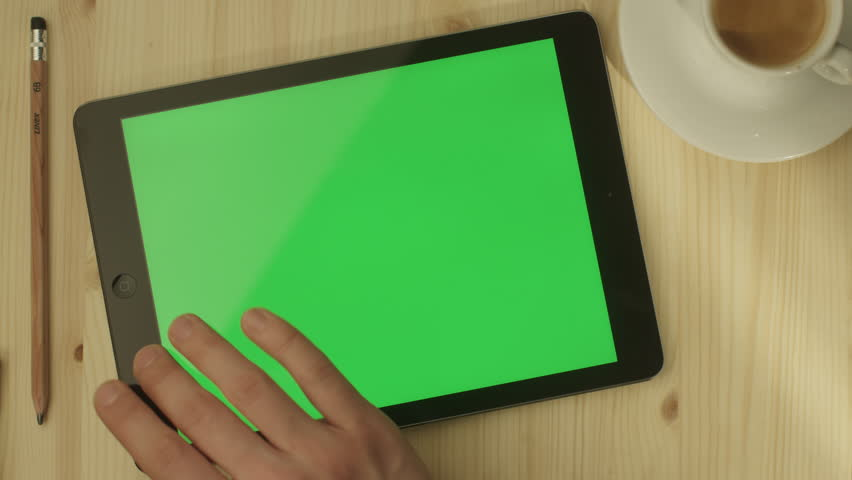Man using Tablet in Coffee Shop. Tablet with Green Screen. Shot on RED Digital Cinema Camera in 4K (ultra-high definition (UHD)), so you can easily crop, rotate and zoom, without losing quality.   Shutterstock HD Video #5820413