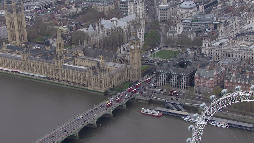 Aerial view of traffic crossing the Thames in the London city of Westminster | Shutterstock HD Video #5821403