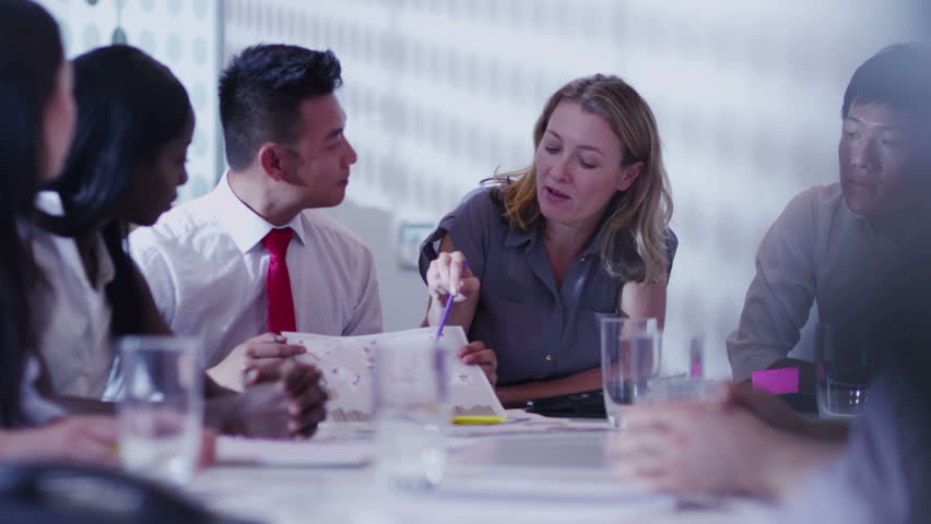 Attractive young multi ethnic business team in a boardroom meeting   Shutterstock HD Video #5843753