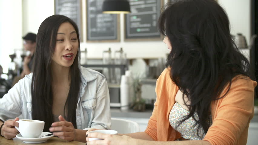 Two female friends sitting at table in cafe chatting.Shot on Sony FS700 in PAL format at a frame rate of 25fps   Shutterstock HD Video #5878019
