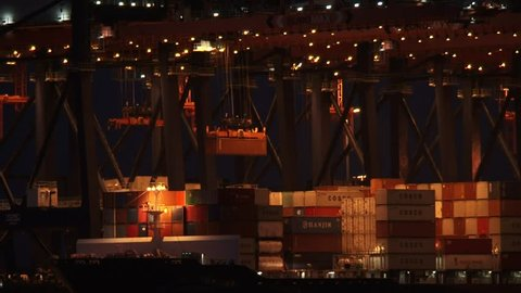 Loading container ship by night at  Euromax Terminal, Yangtzecanal + zoom out. MAASVLAKTE, SEAPORT ROTTERDAM