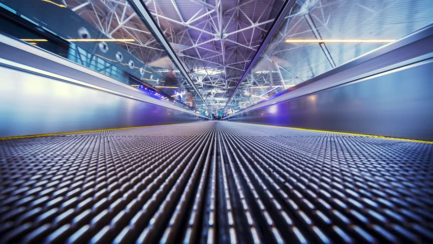 POV of moving walkway in airoprt. Timelapse.