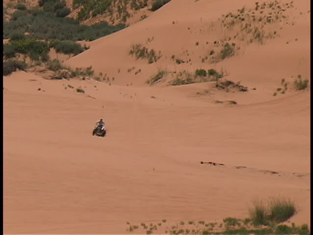 ATVs speed and jump across the red sands of the Coral Pink Sands State Park in southern Utah.