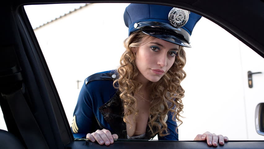 Beautiful Young Women Dressed As A Sexy Police Officer. She Knocks On The  Car Window To Caution The Caru0027s Driver