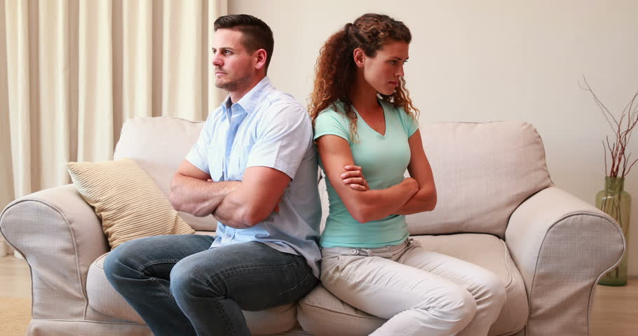 A Couple Talking In A Living Room Stock Image - Image: 58103933
