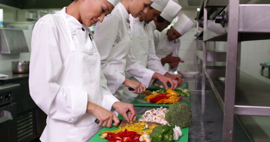 Busy Kitchen chefs at work in a busy kitchen in a commercial kitchen stock