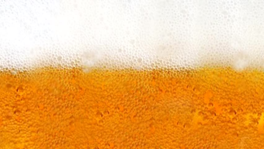 Beer with bubbles and foam in a glass