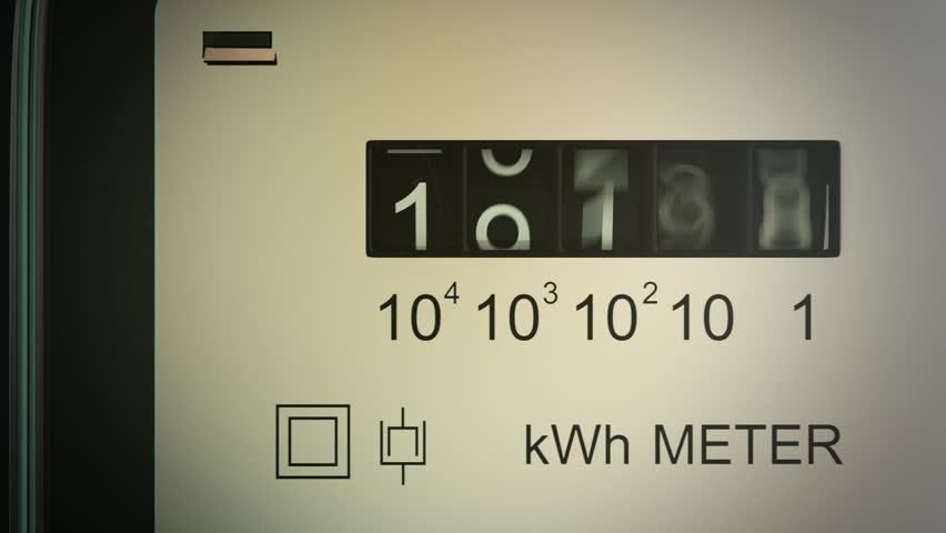 Typical residential analog electric meter with transparent plastic case showing household consumption in kilowatt hours. Electric power usage.