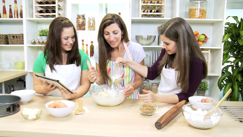 Teenage Caucasian Girls Home Kitchen Counter Having Baking Lesson ...