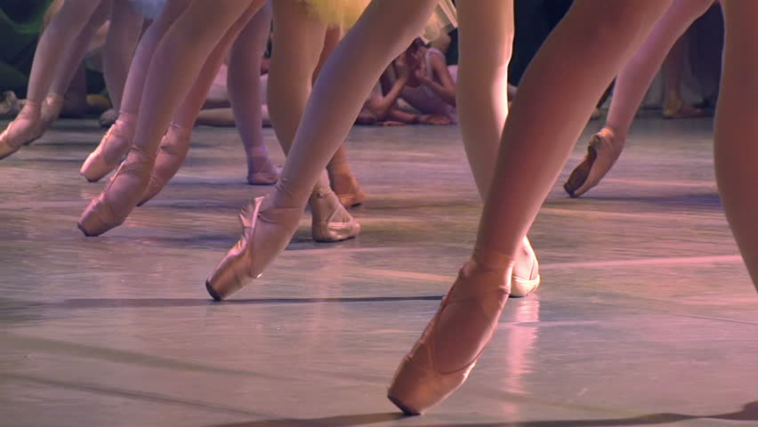 Ballet Performances. Feet in pointe dancing ballerinas on the stage. Slow Motion at a rate of 120 fps