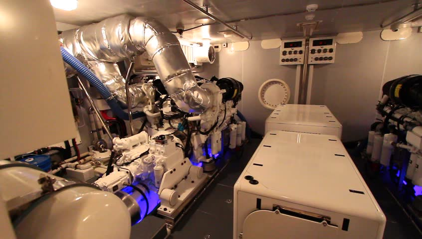Boat Engine Room. Pan across engine room inside a yacht.