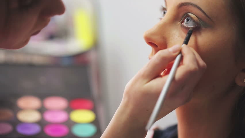 Makeup artist makes models eye makeup | Shutterstock HD Video #5989757
