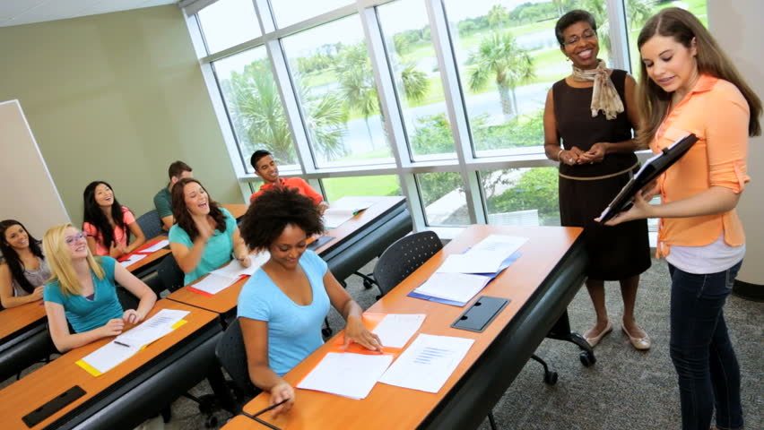 Young Caucasian Female College Student Classroom On Campus Giving ...