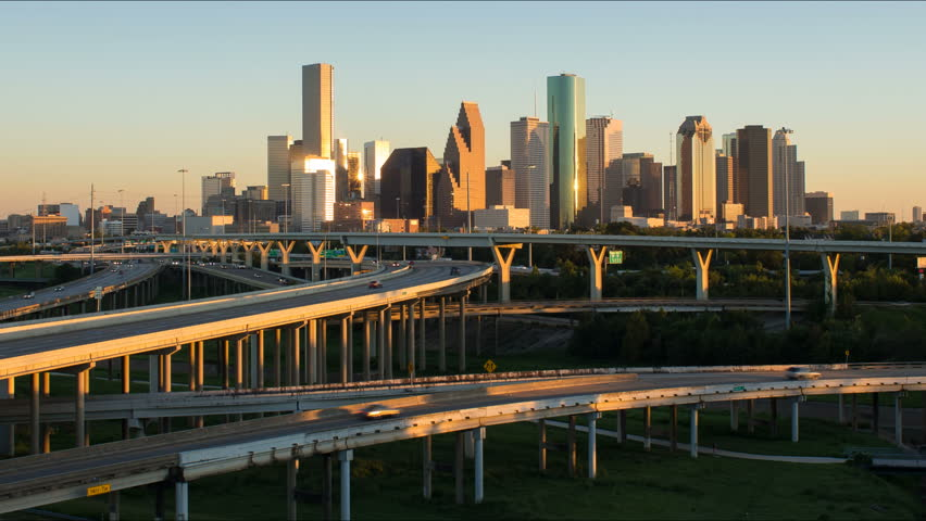 HOUSTON - CIRCA NOVEMBER 2013: Houston, Texas, USA, highway, city skyline, dusk to night