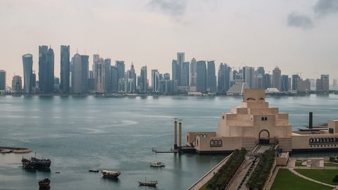 DOHA - CIRCA NOVEMBER 2013: WS POV T/L View Museum of Islamic Art and Dhow harbour at night / Doha, Qatar