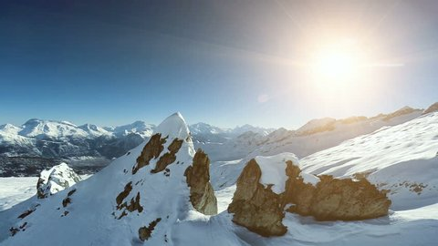 overlooking snow mountains. aerial view. fly over. epic alps panorama. winter landscape