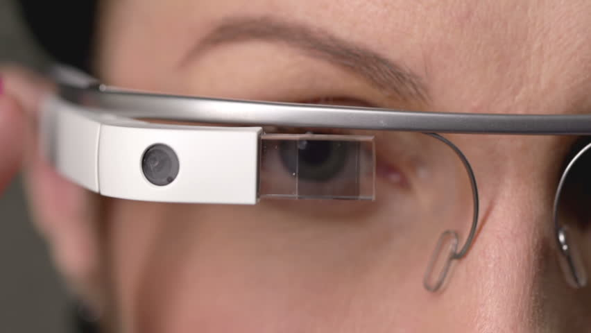 Extreme close up of female's eyes and data popping up on the smart glasses