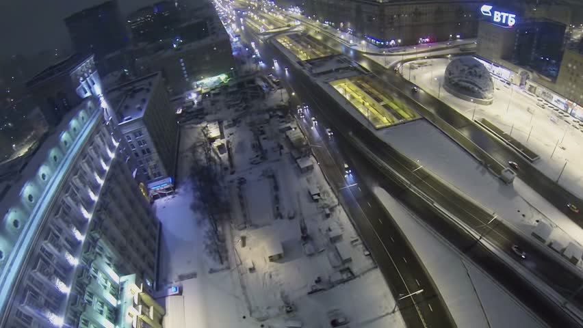 MOSCOW - DEC 8, 2013: Traffic on Leningrad prospect near edifice of headend system design bureau of concern Almaz-Antey at winter night. Aerial view. Design bureau was found in 1947 | Shutterstock HD Video #6079613