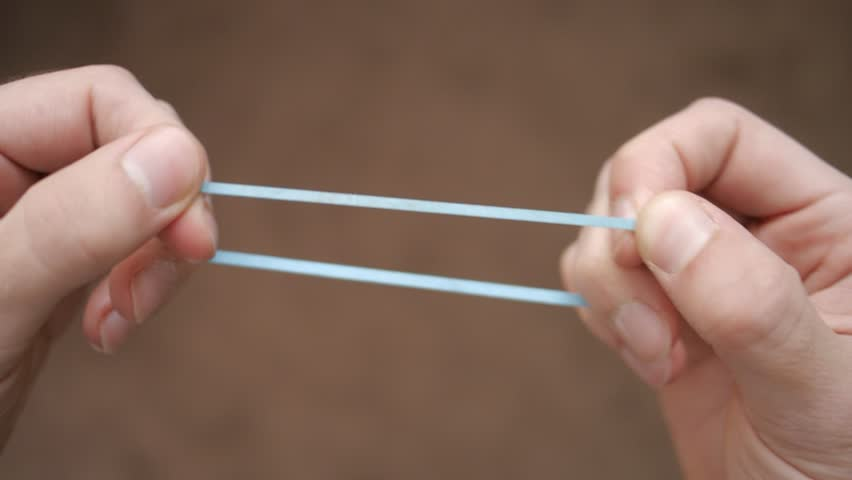 Stretched Rubber Band Stock Footage Video | Shutterstock