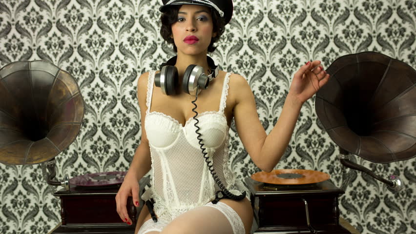 acc940c4d25 beautiful sexy disco woman in white lingerie with gramophones and record  vinyls. Useful for fashion