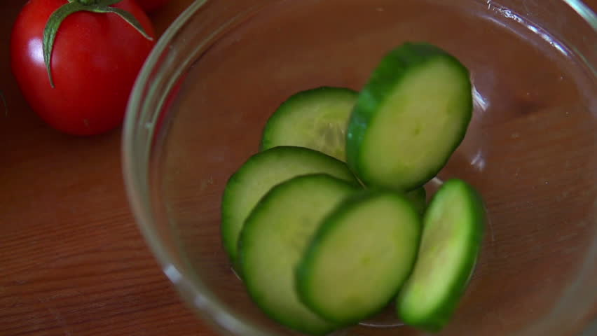 slice cucumber falling into bowl, super slow motion, shot at 240fps