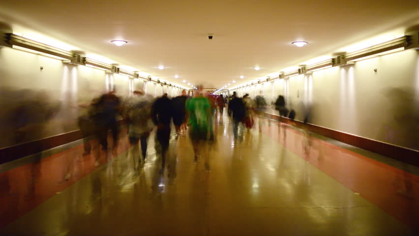 4K Time Lapse of Union Station Hallway with Commuters in Motion Blur -Tilt Up-