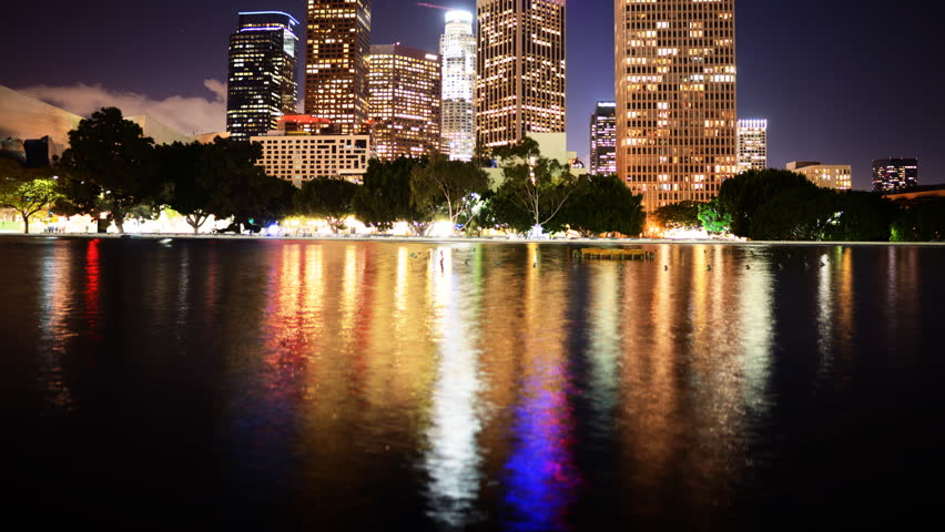 Time Lapse of Downtown Los Angeles with Reflection and Storm Clouds -Tilt Up-