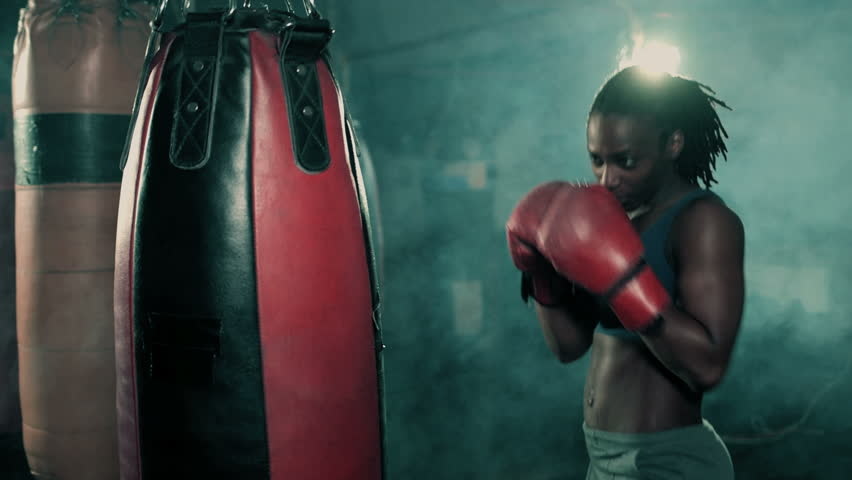 Female Boxer training in Boxing Club